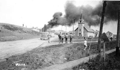 Babcock fire, Grace Lutheran church on the right smoke to the left. Dawson Creek , B.C., June 2, 1943