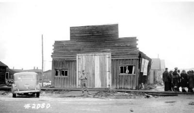 Fire and Explosion February 13, 1943, The day after. Other buildings damaged, 102nd Ave., west side of 11th St. Dawson Creek , B.C., February 14, 1943
