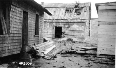 Fire and Explosion February 13, 1943, The day after. Other buildings damaged, Alaska Ave. and west side of 11th St. Dawson Creek , B.C., February 14, 1943