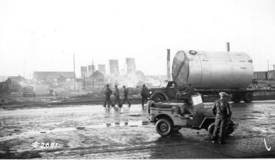 Fire and Explosion February 13, 1943, The day after. 102nd Ave , the burn out block, US soldiers patrolling the area. Dawson Creek , B.C., February 14, 1943