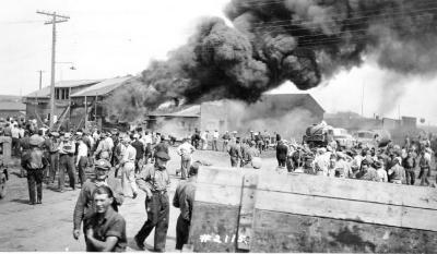 Babcock Garage fire, located 102 Ave in the 1100 block small building in the front of the lot. Dawson Creek , B.C., June 2, 1943