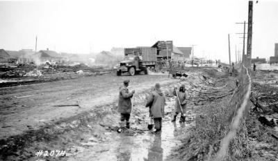Fire and Explosion February 13, 1943, The day after. US Army helping with the clean-up. Dawson Creek , B.C., February 14, 1943