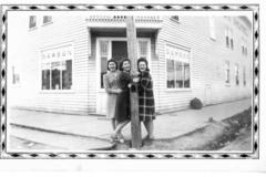 3 unidentified, one may be Irma Babcock  women in front of the Dawson Hotel,   Dawson Creek, BC 1942-43