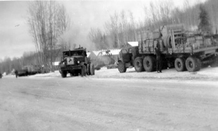 At Mile N-8, Fort Nelson, B.C. Trucks loaded with refinery equipment for Canol Project at Whitehorse. Trucks hauling out equipment to Dawson Creek, B.C. Feb 1, 1944