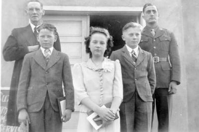 Comfirmation , Grace Lutheran Church, Back row: Rev. Aashiem and American Soldier, Front Row: Allen (Spike Johnson, Marion Aashiem, and Norn Ellingsen. Dawson Creek, B.C. ca 1940