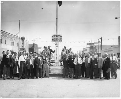 "Vancouver's Board of Trade gathered at the Mile ""0"" Post.  Dawson Creek, BC, July 1958"