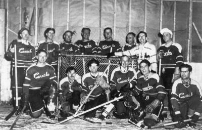 14 members of the Dawson Creek Canucks Hockey Team, (not in order) Fred Newby, Don Waugh, Bob Esau, Roald Dahlen and Jim McPhail, Dawson Creek, B.C.