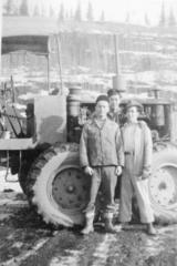 3 unidentified men standing beside a piece of heavy machinery, Camp 2, Hart Highway, B.C. April 1946