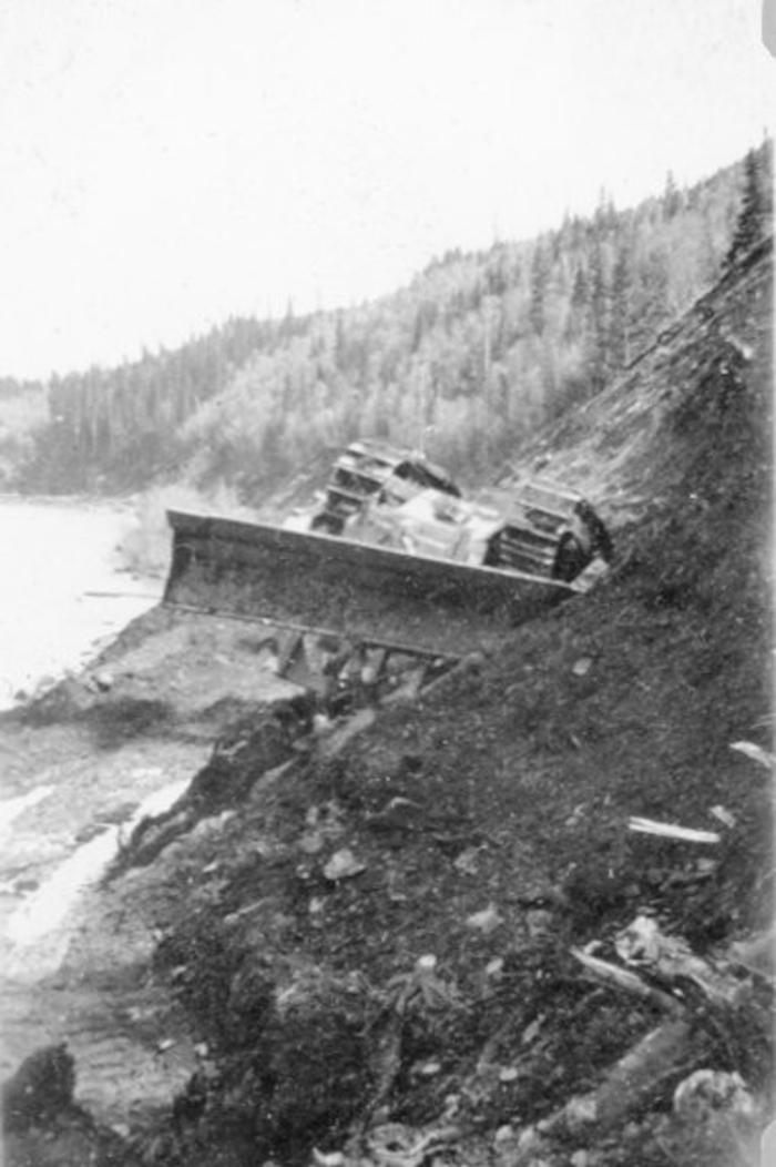 Overturned crawler tractor, Construction of the Hart Highway, B.C. 1946-47