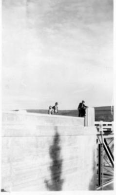2 unidentified men and 1 woman on Peace River Bridge at Taylor, B.C. 1943-44