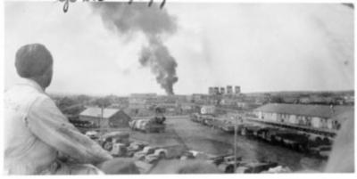 Spence Pepper watching the smoke from the Babcock Garage fire, Dawson Creek, B.C. 1943