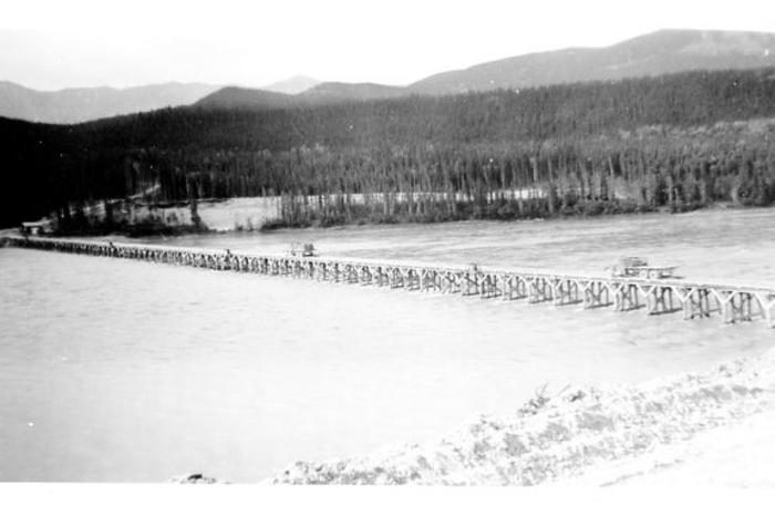 The Liard river and temporary bridge, 210 miles north of Ft. Nelson. Two Sterling Diesels are shown crossing.