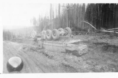 Truck with load of lumber overturned in ditch, Alaska Highway, B.C. 1943-44