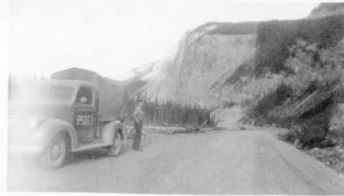 Unidentified man standing alongside truck #P5053, Alaska Highway, B.C. 1943-44