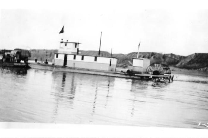 "the ""M.V. Alcan"" barge, carried all heavy traffic across the Peace River. A temporary bridge sufficed while the river was frozen."