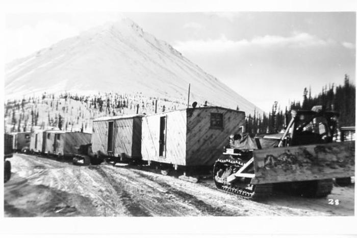 Cat trains. On the Canol side of the road most camps consisted of these types of structures, built on runners to help in easier moving about, mostly to follow the laying of the pipe-line.