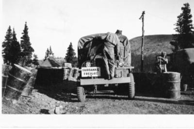 "Army truck with a ""Fairbanks Freight"" sign, Alaska Highway, B.C. 1941-1944"
