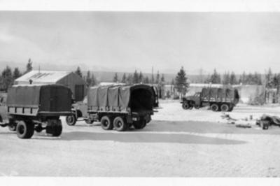 3 army trucks parked on the base, Alaska Highway 1941-1944