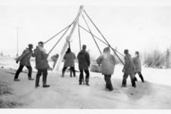 8 men raising a telephone pole, Alaska Highway 1941-1944