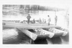 8 men on pontoons constructing a temporary bridge, Alaska Highway 1941-1944