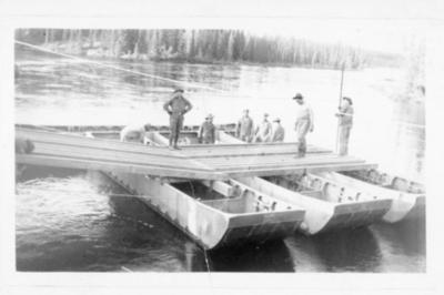8 men on pontoons constructing a temporary bridge, Alaska Highway 1941-1944
