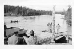 5 unidentified military personnel building a temporary bridge, Alaska Highway 1941-1944