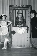 3 cast members in unidentified theatrical production