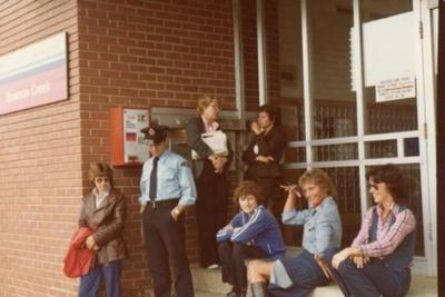 7 unidentified people outside Post Office, Dawson Creek, August 1980
