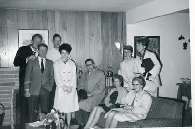 John Todrick, Guy Mills, Andy Anderson, Beth Todrick, Ken McAdam, Mary Anderson (sitting), Clara Overend, Mrs. Ken McAdam and Mrs. Mills, Fort St. John Library Board members, 1968