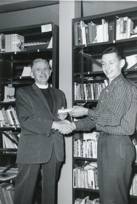 Chris Bartsch presents farewell gift to Archdeacon C.A. Hinchliffe of Pouce Coupe, June 22, 1965