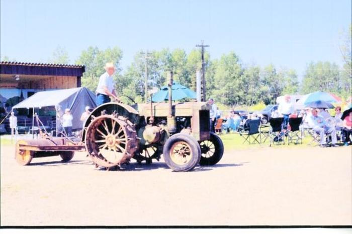 Pioneer Village Opening and Parade, JD Tractor and Roller, Driven by Stu Flinn. June 21, 2013