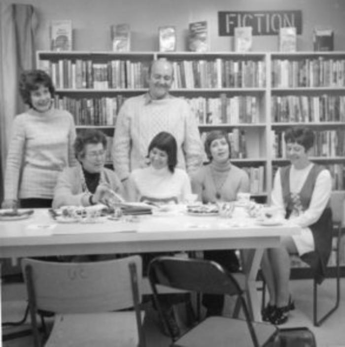 (back) Alice Summer and Bill Sutton (seated) Anita McWilliams, Daphne Samuel, Valentina Paganuzzi and Ruth Poschner (librarian), Board members, Hudson's Hope Public Library, February 1973