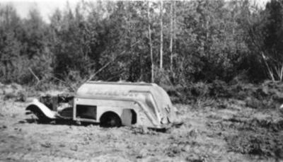 Burnt tanker truck, 235J, Alaska Highway, B.C., 1942-1943