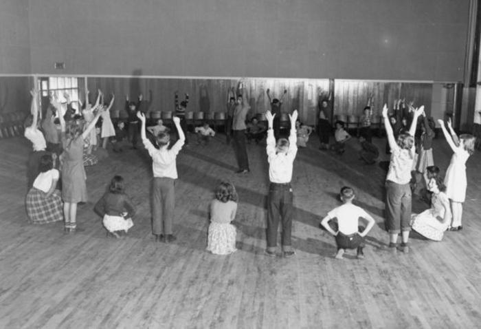 Physical education class in Activity room, Ken Smith, teacher, Dawson Creek Elementary School, 1952