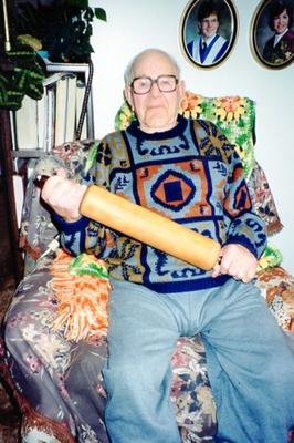 Jack Solodan holding a Ball-bearing equipped Rolling Pin, destine for the Army Dump, 1944, relates to Story in 2003.013.018, picture 1992