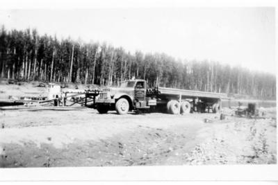 Pipe Truck along the Alaska Highway, 1942-1943, related to story in 2003.013.012