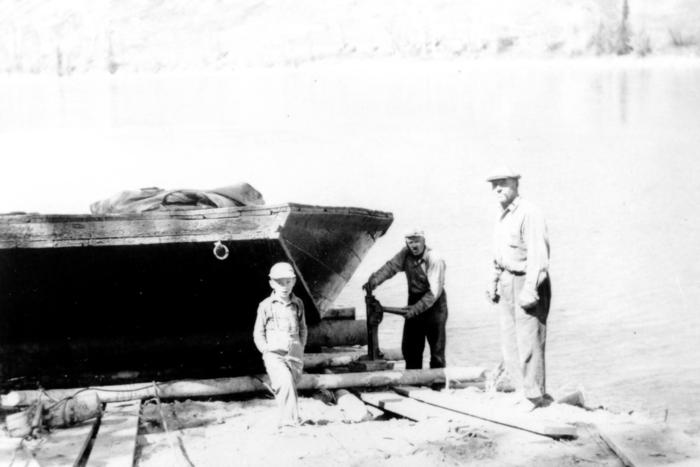 Marshall Miller and John Riske launching their barge into the Peace River at the portage. 1947