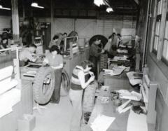 7 unidentified men and women in the Northwest Service Command, Tire & Battery Repair Shop, Dawson Creek, B.C., 1942-1944