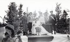 5 unidentified women, a man and child, Winter Pageant, Whitehorse, Yukon, 1940-1944