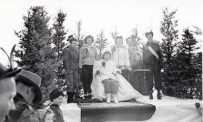 5 unidentified women, a man and child, Winter Pageant, Whitehorse, Yukon, 1940-1944