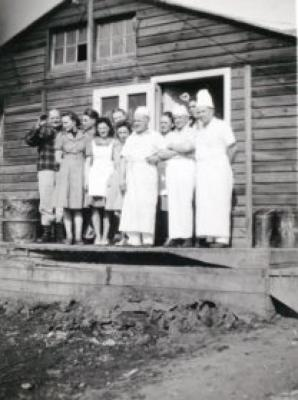 11 unidentified men and women (3 men appear to be cooks), Mess hall, Dawson Creek, B.C., 1940-1944