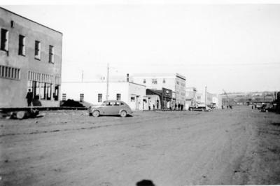 10th Street West Side, Dawson Creek, BC, New Harper's Store being built, post office, Wade's, and Dew Drop Inn, 1943-1944