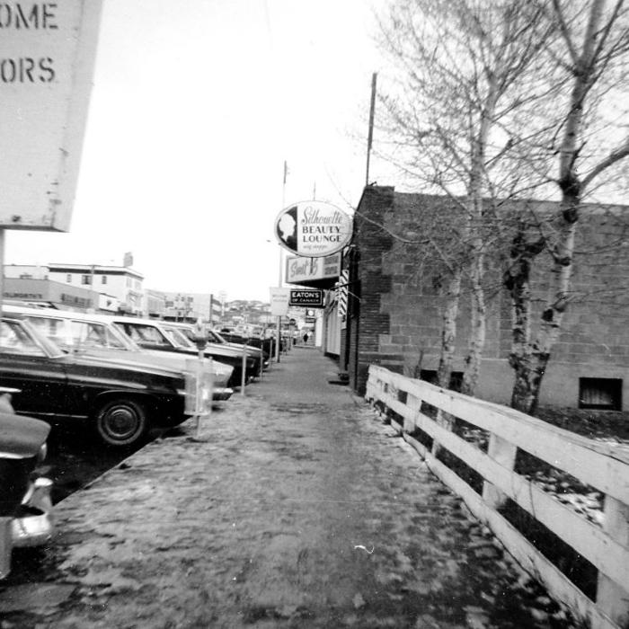 This is a whole row of parking meters and signs. Dawson Creek, BC 1970